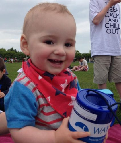 Child with fundraising tin